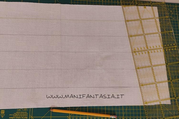 astuccio di stoffa con i cordoncini e bottoni step 1
